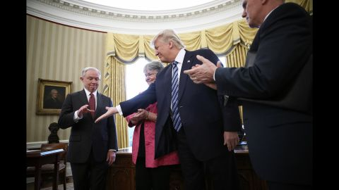 """Trump offers his hand to Jeff Sessions, who had just been sworn in as the new attorney general on February 9. Sessions, one of Trump's closest advisers and his earliest supporter in the US Senate, <a href=""""http://www.cnn.com/2017/02/08/politics/jeff-sessions-vote-senate-slog/"""" target=""""_blank"""">was confirmed by a 52-47 vote</a> that was mostly along party lines. He was accompanied to the swearing-in by his wife, Mary."""