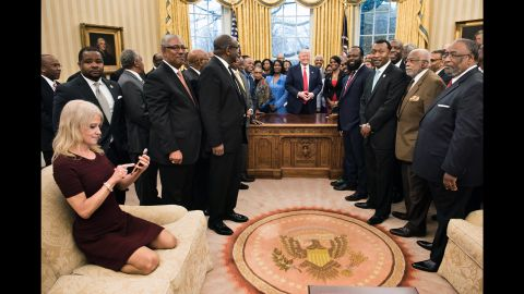 """White House Adviser Kellyanne Conway takes an Oval Office photo of Trump and leaders of historically black colleges and universities on Monday, February 27. The image of her kneeling on the couch <a href=""""http://www.cnn.com/videos/politics/2017/02/28/kellyanne-conway-oval-couch-photo-orig-vstan.cnn"""" target=""""_blank"""">sparked memes on social media.</a>"""