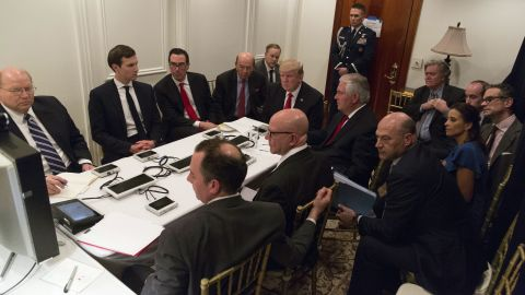 """In this image provided by the White House, Trump is briefed by his national security team about <a href=""""http://www.cnn.com/2017/04/06/politics/gallery/us-strikes-syria/index.html"""" target=""""_blank"""">the missile strike in Syria</a> on April 6. They were at a secured location on Trump's Mar-a-Lago resort."""