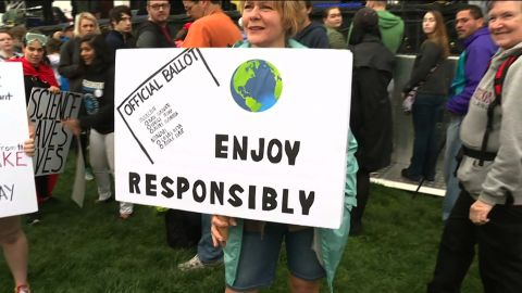 March for Science participant holds sign