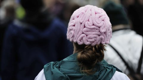 A woman wears a brain beanie during the March for Science in Portland.