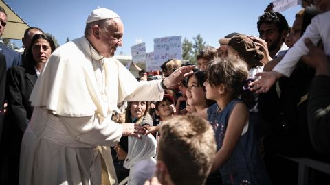 MYTILENE, GREECE - APRIL 16:  In this handout image provided by Greek Prime Minister's Office, Pope Francis meets migrants at the Moria detention centre on April 16, 2016 in Mytilene, Lesbos, Greece. Pope Francis will visit migrants at the Moria camp on the Greek island of Lesbos along with Greek Orthodox Ecumenical Patriarch Bartholomew I and Archbishop of Athens and All Greece, Ieronimos II.  (Photo by Andrea Bonetti/Greek Prime Minister's Office via Getty Images)