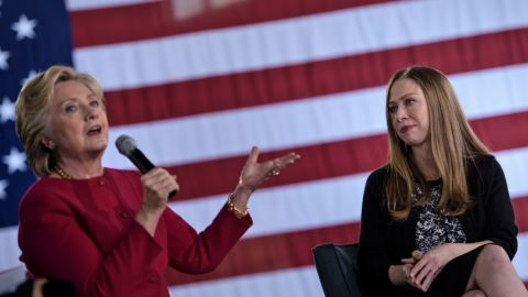 Chelsea Clinton (R) listens as Democratic presidential nominee Hillary Clinton speaks during a town hall meeting October 4, 2016 in Haverford, Pennsylvania. / AFP / Brendan Smialowski        (Photo credit should read BRENDAN SMIALOWSKI/AFP/Getty Images)