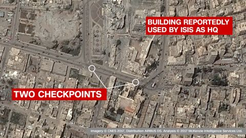 Checkpoints in front of reported ISIS HQ: The imagesclearly showtwo checkpoints in the main road outside a key governate building, which ISIS have reportedly used as a headquarters. The building itself is -- on the satellite imagery -- seen as damaged but still standing, suggesting a precision coalition airstrike.