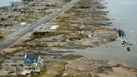 GILCHRIST, TX - SEPTEMBER 14:  A home is left standing among debris from Hurricane Ike September 14, 2008 in Gilchrist, Texas. Floodwaters from Hurricane Ike are reportedly as high as eight feet in some areas causing widespread damage across the coast of Texas.  (Photo by Smiley N. Pool-Pool/Getty Images)