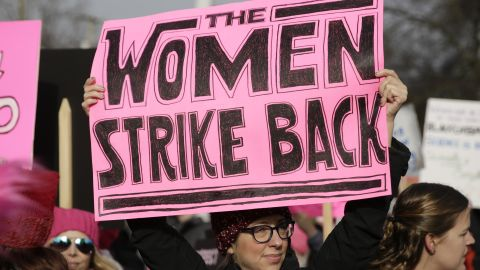 """People gather at Judkins Park during the Women's March in Seattle, Washington on January 21, 2017.  Led by women in pink """"pussyhats,"""" hundreds of thousands of people packed the streets of Washington and other cities Saturday in a massive outpouring of defiant opposition to America's hardline new president, Donald Trump. / AFP / Jason Redmond        (Photo credit should read JASON REDMOND/AFP/Getty Images)"""