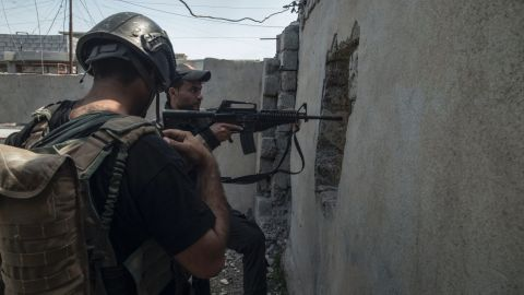 Soldiers from Iraqi special forces Golden Division conduct ground raids in west Mosul's al Tank neighborhood on April 17.