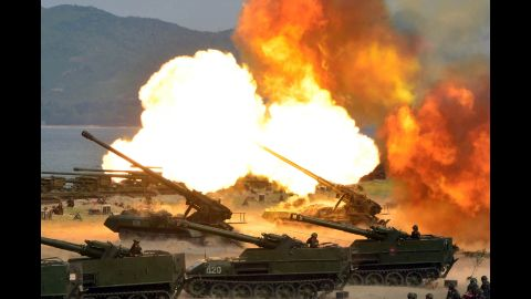 """TOPSHOT - This undated picture released by North Korea's official Korean Central News Agency (KCNA) on April 26, 2017 shows the combined fire demonstration of the services of the Korean People's Army in celebration of its 85th founding anniversary at the airport of eastern front. / AFP PHOTO / KCNA VIA KNS / STR / South Korea OUT / REPUBLIC OF KOREA OUT   ---EDITORS NOTE--- RESTRICTED TO EDITORIAL USE - MANDATORY CREDIT """"AFP PHOTO/KCNA VIA KNS"""" - NO MARKETING NO ADVERTISING CAMPAIGNS - DISTRIBUTED AS A SERVICE TO CLIENTSTHIS PICTURE WAS MADE AVAILABLE BY A THIRD PARTY. AFP CAN NOT INDEPENDENTLY VERIFY THE AUTHENTICITY, LOCATION, DATE AND CONTENT OF THIS IMAGE. THIS PHOTO IS DISTRIBUTED EXACTLY AS RECEIVED BY AFP.  /         (Photo credit should read STR/AFP/Getty Images)"""