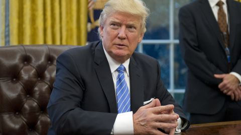 WASHINGTON, DC - JANUARY 23:  (AFP OUT) U.S. President Donald Trump prepares to sign three Executive Orders in the Oval Office of the White House in Washington, DC on Monday, January 23, 2017.  (Photo by Ron Sachs - Pool/Getty Images)