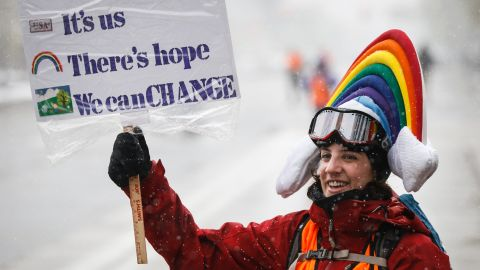 Meteorologist Lis Cohen of Denver, Colorado holds a sign while cheering on protesters at the People's Climate March on Denver on April 29, 2017 in Denver, Colorado. The protest, which focused on climate change, coincided with President Donald Trump's 100th day in office.