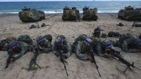 South Korean Marines take position on a beach during a joint landing operation by US and South Korean Marines in the southeastern port of Pohang on April 2, 2017. The drill is part of the annual joint exercise Foal Eagle to enhance the combat readiness of the US and South Korea supporting forces in defense of the Korean Peninsula.  / AFP PHOTO / JUNG Yeon-Je        (Photo credit should read JUNG YEON-JE/AFP/Getty Images)