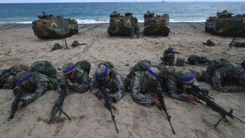 South Korean Marines take position on a beach during a joint landing operation by US and South Korean Marines in the southeastern port of Pohang on April 2, 2017.