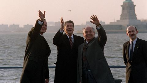 """Ronald Reagan, Mikhail Gorbachev, George Bush all wave to the press corps. Film still from """"The Reagan Show."""""""