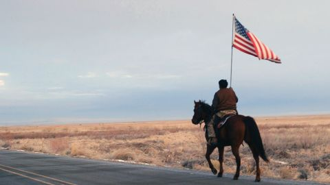 """Duane Ehmer rides out to confront the press after the killing of Lavoy Finicum. Film still from """"No Man's Land."""""""
