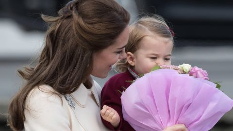 Catherine holds flowers for Charlotte to smell as they leave Victoria, British Columbia, in October 2016.