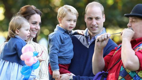 The royal family watches an entertainer blow up a balloon during a children's party in Victoria in September 2016.