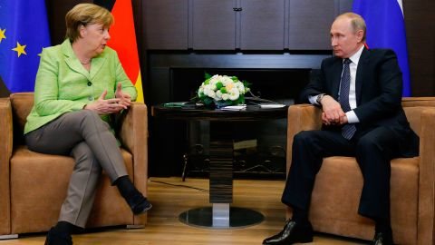 Merkel (L) with Putin at the Bocharov Ruchei residence in Sochi on Tuesday.