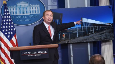 Office of Management and Budget Director Mick Mulvaney points to an image for a border fence during a briefing in the Brady Briefing Room of the White House on May 2, 2017 in Washington, DC. / AFP PHOTO / MANDEL NGAN        (Photo credit should read MANDEL NGAN/AFP/Getty Images)