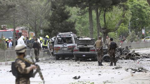 Security forces inspect at the site of a suicide attack in Kabul, Afghanistan, on Wednesday.