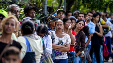 Many Venezuelans must stand in line to buy what little food is available.