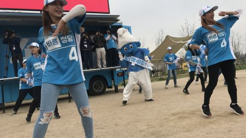 Supporters of South Korean presidential candidate Yoo Seong-min dance with a giant Smurf.