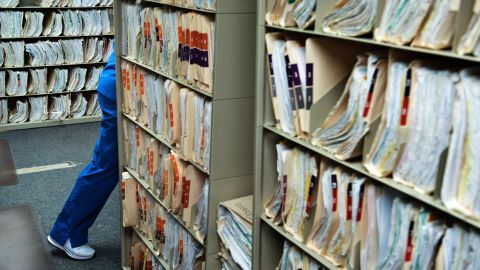 A staff member walks past medical records at the Cornerstone Care Community Health Center of Rogersville March 21, 2017 in Rogersville, Pennsylvania. The Republican-controlled House of Representatives votes Thursday on a key plank of Trump's legislative agenda -- his plan to repeal and replace Obamacare, his predecessor's crowning domestic policy achievement.