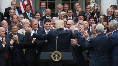 WASHINGTON, DC - MAY 04: President Donald Trump (C) congratulates House Republicans after they passed legislation aimed at repealing and replacing ObamaCare, during an event in the Rose Garden at the White House, on May 4, 2017 in Washington, DC. (Photo by Mark Wilson/Getty Images)