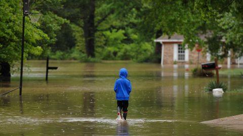 A child walks in his flooded neighborhood Thursday in Arnold, Missouri.