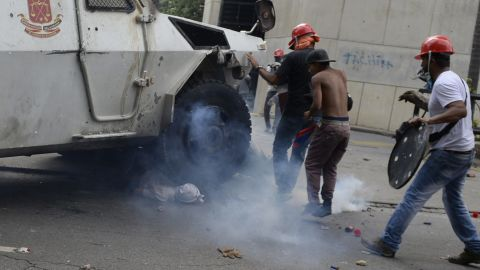 """An armored National Guard vehicle <a href=""""http://www.cnn.com/2017/05/05/americas/venezuela-unrest-tank/"""" target=""""_blank"""">runs over a protester</a> in Caracas on Wednesday, May 3. The protester, 22-year-old Pedro Michell Yaminne, survived, his mother told CNN. Interior and justice minister Nestor Reverol told reporters that the """"lamentable"""" incident was under investigation. He said that moments before Yaminne was run over, demonstrators hurled a Molotov cocktail at the armored vehicle, opened the side door and """"brutally assaulted"""" the driver."""