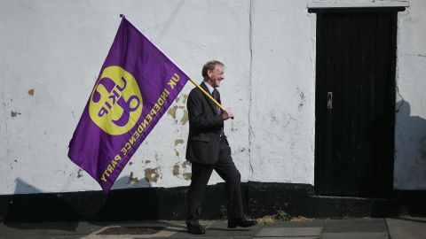 HARTLEPOOL, ENGLAND - APRIL 29: A UK Independence party supporter carries a party flag as leader Paul Nuttall visits Hartlepool on April 29, 2017 in Hartlepool, United Kingdom. Mr Nuttall announced he would stand in the Boston and Skegness constituency when Britain goes to the polls on June 8, 2017 after British Prime Minister Theresa May called for a snap general election.  (Photo by Ian Forsyth/Getty Images)