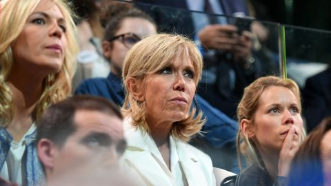 Trogneux (C) with her daughters Tiphaine Auziere (R) and Laurence Auziere-Jourdan at a campaign meeting in Paris.