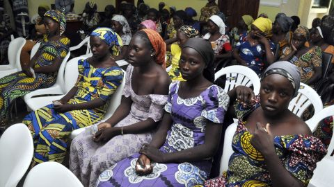 Chibok school girls recently freed from Boko Haram captivity are seen in Abuja, Nigeria, Sunday, May 7, The 82 freed Chibok schoolgirls arrived in Nigeria's capital on Sunday to meet President Muhammadu Buhari as anxious families awaited an official list of names and looked forward to reuniting three years after the mass abduction.