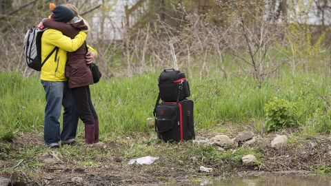A woman and a man embrace after she evacuated her home in Montreal on May 7.
