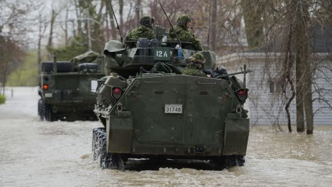 Members of the Canadian armed forces patrol a street in Rigaud on May 7.