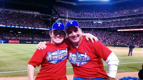 Ryan with his father at a Texas Rangers World Series game in 2010.