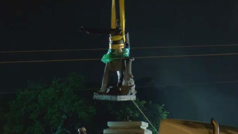 The Jefferson Davis statue was lifted from its pedestal shortly after 5 a.m. CT Thursday.