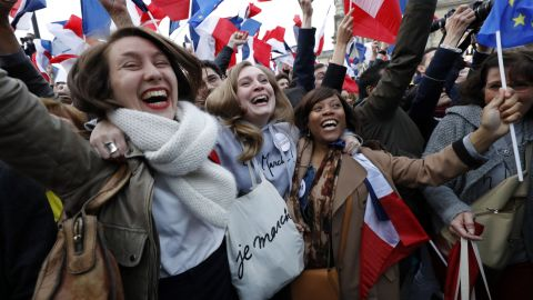Supporters of French presidential election candidate for the En Marche ! movement Emmanuel Macron celebrate in front of the Pyramid at the Louvre Museum in Paris on May 7, 2017, following the announcement of the results of the second round of the French presidential election. Emmanuel Macron was elected French president on May 7, 2017 in a resounding victory over far-right Front National (FN - National Front) rival after a deeply divisive campaign, initial estimates showed. / AFP PHOTO / Patrick KOVARIK        (Photo credit should read PATRICK KOVARIK/AFP/Getty Images)