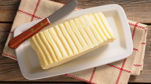 """The third most damaging food, by some distance, is butter: one kilo of butter equals nearly 12 kilos of CO2 -- about half as many as beef. It belongs to the same supply chain, making dairy and beef cattle an environmentalist's nightmare.<br /><br />While Americans have greatly reduced their consumption of red meat in recent years, the NRDC reports that butter and other dairy products such as cheese and yogurt actually enjoyed a surge in the observed period, from 2005 to 2014.<br /><br />Butter is the most climate damaging of all dairy products because there are several steps involved in producing it that are energy-intensive: """"For example, butter production requires separating raw milk into low-fat milk and cream, pasteurizing the cream, cooling the cream, ripening and churning,"""" Sujatha Bergen told CNN."""