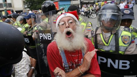 """During a <a href=""""http://www.cnn.com/2017/05/12/americas/venezuela-grandparents-march/"""" target=""""_blank"""">""""Grandparents' March""""</a> in Caracas, a man is blocked by police from reaching the Government Ombudsman's Office on Friday, May 12."""