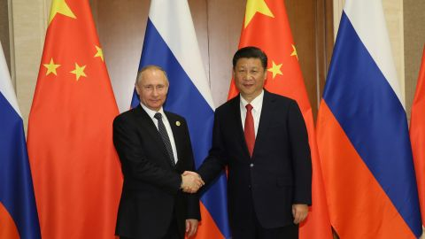 BEIJING, CHINA  - MAY 13: Russian President Vladimir Putin (L) shakes hands with Chinese President Xi Jinping ahead a bilateral meeting at Diaoyutai State Guesthouse in Beijing, China, 14 May 2017. The Belt and Road Forum focuses on the One Belt, One Road (OBOR) trade initiative. (Photo by Wu Hong-Pool/Getty Images)