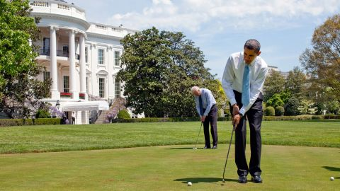 President Barack Obama and Vice President Joe Biden putt on the White House putting green April 24, 2009.