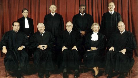 Kennedy is on the far right in this Supreme Court portrait from 1998. In the front row, from left, are Antonin Scalia, John Paul Stevens, Chief Justice William Rehnquist, Sandra Day O'Connor and Kennedy. In the back row, from left, are Ruth Bader Ginsburg, David Souter, Clarence Thomas and Stephen Breyer.