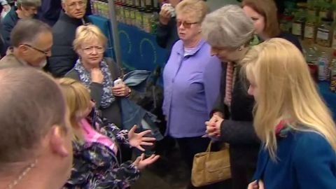 theresa may confronted disability benefits bts_00002621.jpg