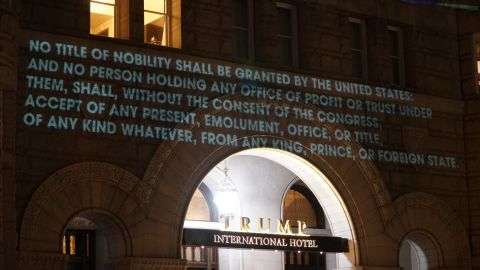 The text of the emoluments clause was projected onto the hotel.