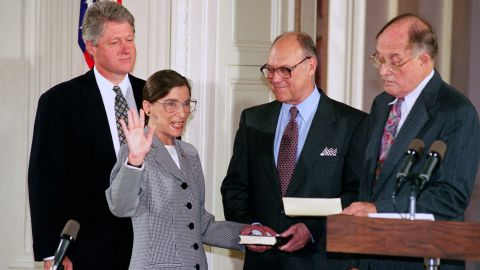 Ginsburg takes the Supreme Court oath from Chief Justice William Rehnquist, right, in August 1993. Joining them were Clinton and Martin Ginsburg.