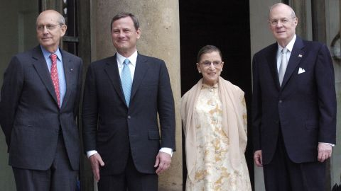 From left, Supreme Court Justices Stephen Breyer, John Roberts, Ginsburg and Anthony Kennedy pose for a photo before meeting with French President Nicolas Sarkozy in Paris in July 2007.