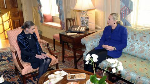 Ginsburg visits with Secretary of State Hillary Clinton at the State Department in Washington in 2012.