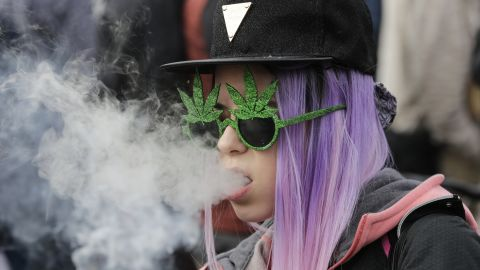A resident smokes a large cannabis joint during a marijuana festival last year.