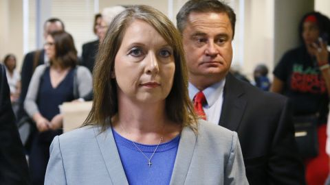 Betty Shelby leaves the courtroom with her husband, Dave Shelby, right, after the jury in her case began deliberations in Tulsa, Okla., Wednesday, May 17, 2017. Shelby, who fatally shot an unarmed black man last year, was found not guilty later Wednesday of first-degree manslaughter. (AP Photo/Sue Ogrocki)