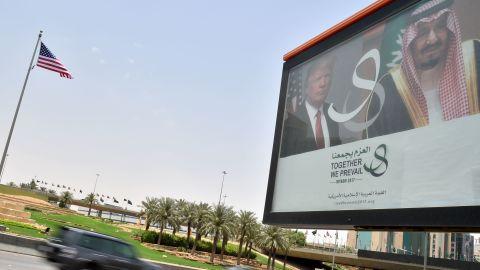 A giant billboard bearing portraits of President Donald Trump and Saudi Arabia's King Salman, is seen on a main road in Riyadh, on May 19, 2017.